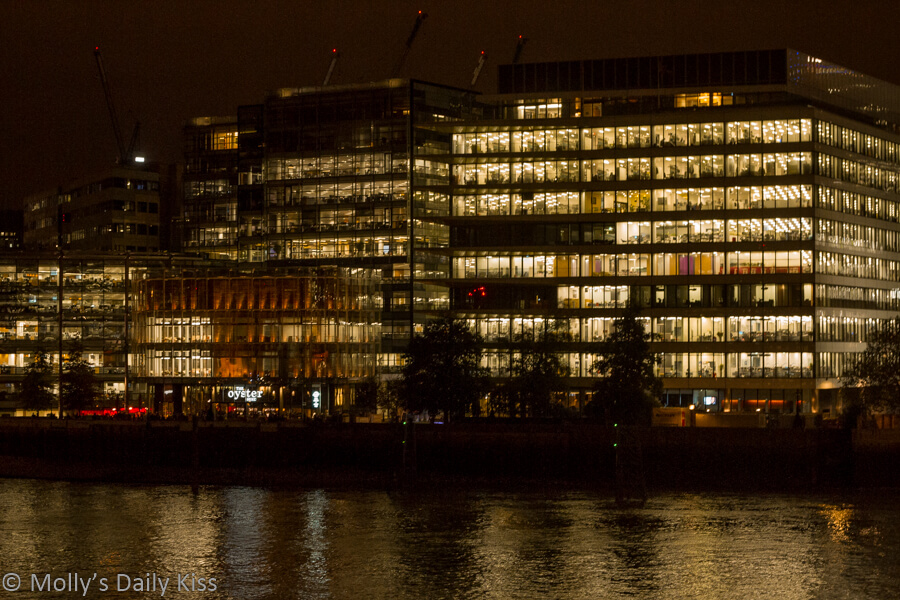 Office lights reflected in river thames