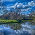 Blue sky reflection in lake at Bennington Lordship, Hertfordshire