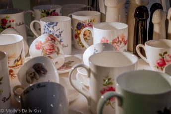 Cups and saucers with naughty words on them