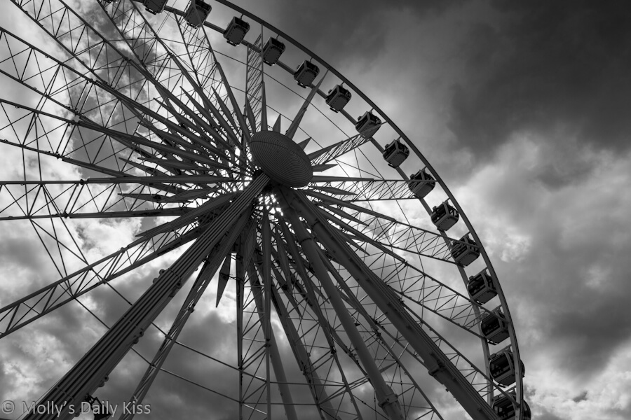Ferris wheel, Brighton against the dark moody sky in Black and White, high and low