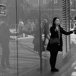 Reflection of young couple in the glass at Kings Cross Station, who are they
