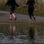 Runner feet reflected in pond St Albans