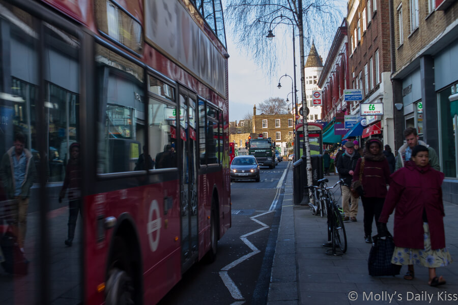Relfection of people in London bus Kentish Town