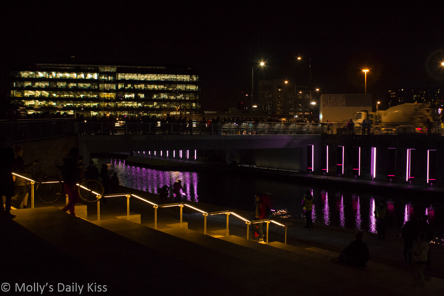 Light show in regeneration area of Kings Cross regents canel relfections