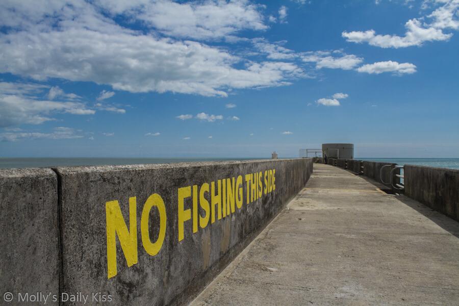 No Fishing words on Brighton breakwater wall Brighton Marina