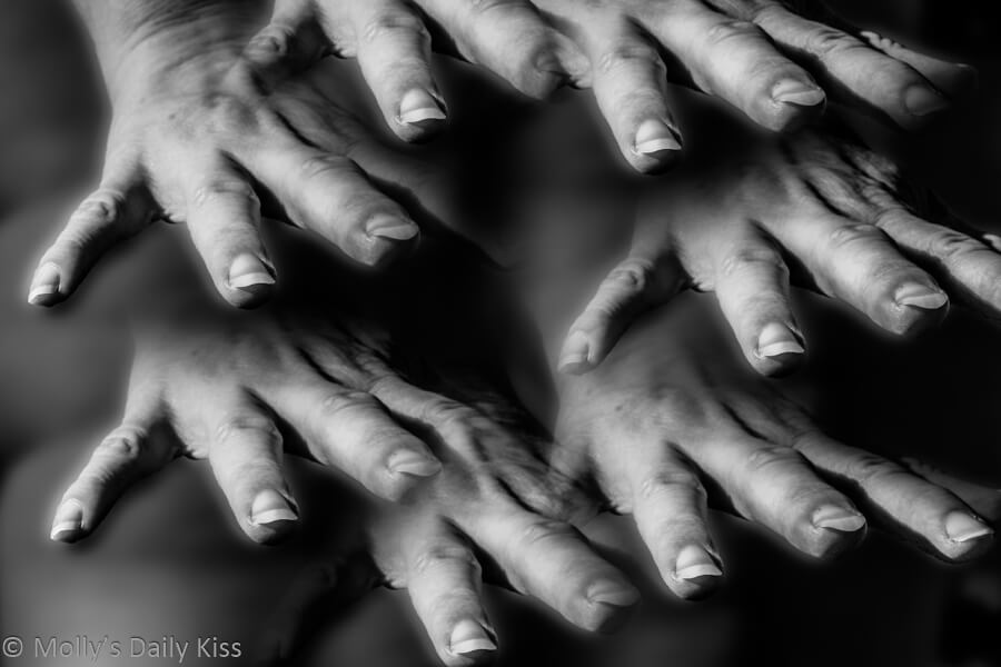 Self portrait of hands reaching out touching