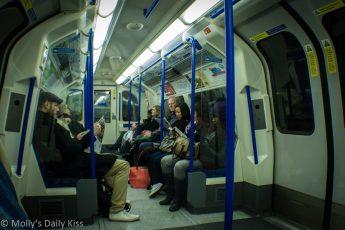 People sitting silent on the London underground