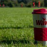 Wawa coffee cup on football field in England