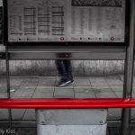 Bus top with man walking past, walk in London