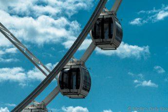 Empty Ferris wheel pods brighton against blue sky