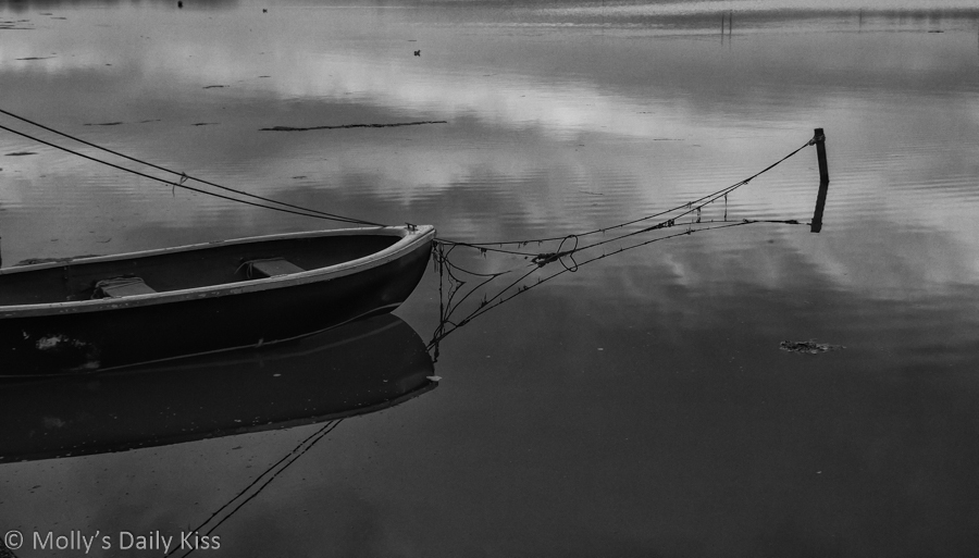 Black and white of boat in the water gray palette of colour