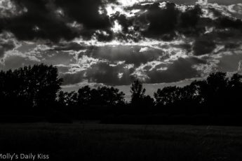 Clouds with sun shining through black and white, sweetest summer