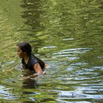 Girl swimming in water St Peter's Village water