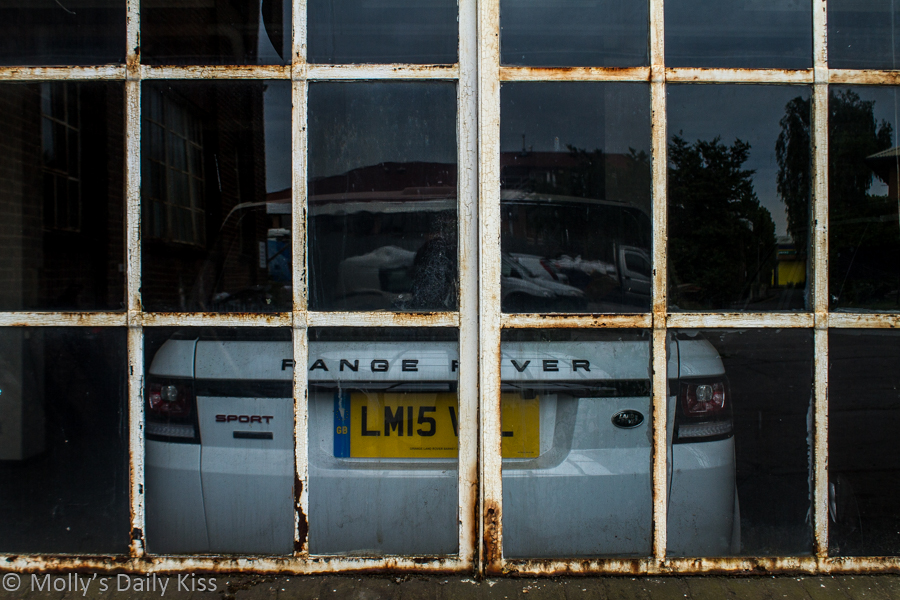 Car parked inside old warehouse