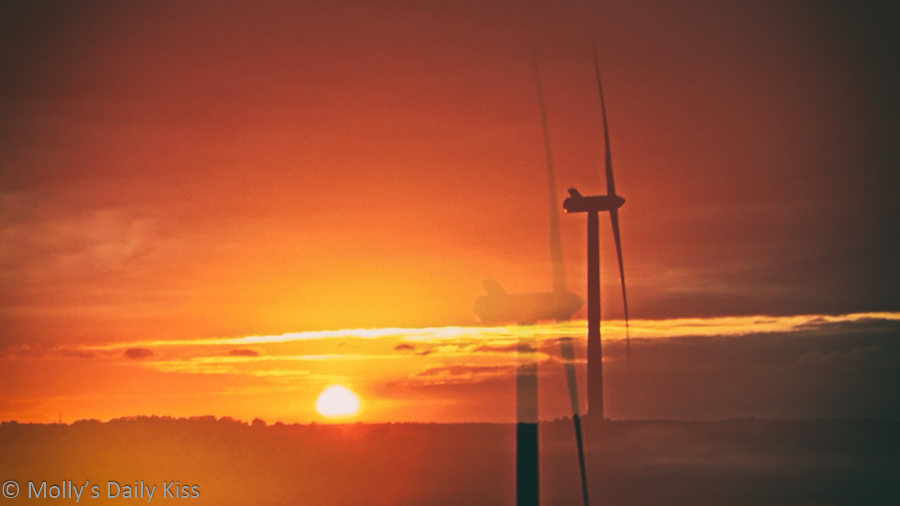 Wind power generator with sunset, renewable