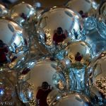 Self portrait reflection in christmas baubles