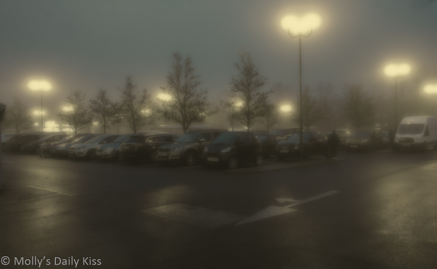 Car park on cold winter night shroaded in foggy mist