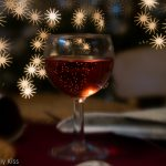 Red sparkling drink with bokeh christmas lights Merry Christmas