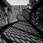Train foot bridge in black and white. Journey on