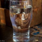 reflection of coffee in glass of water. Start the day