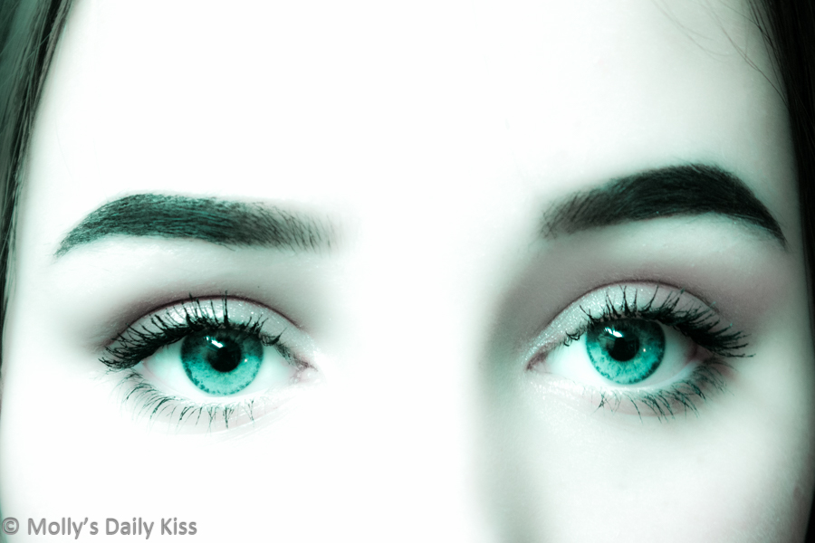 Aqua green eyes of young girl