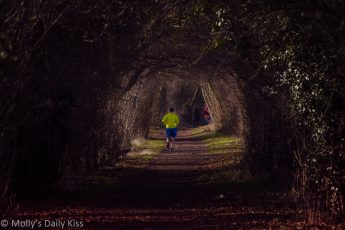 A male runner on rural footpath. Running is therapy