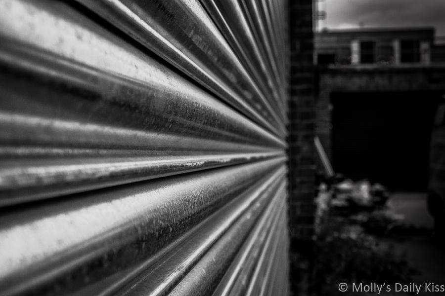 Metal garage door in black and white