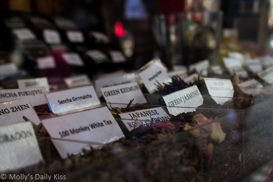 Loose leaf tea with labels in shop window