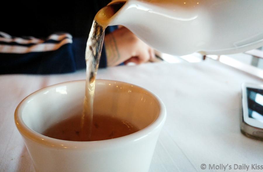 Pouring jasmine tea into teacup