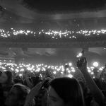 Passgenger concert crowd with mobile phones all alight