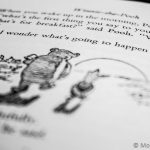 Black and white shot text in winnie the pooh book where they talking exciting things