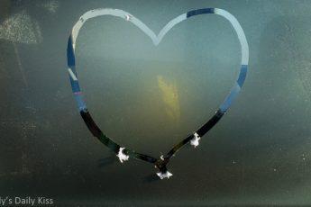 Heart drawn in frost on window