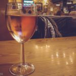 Glass of Rosa wine on table in pub