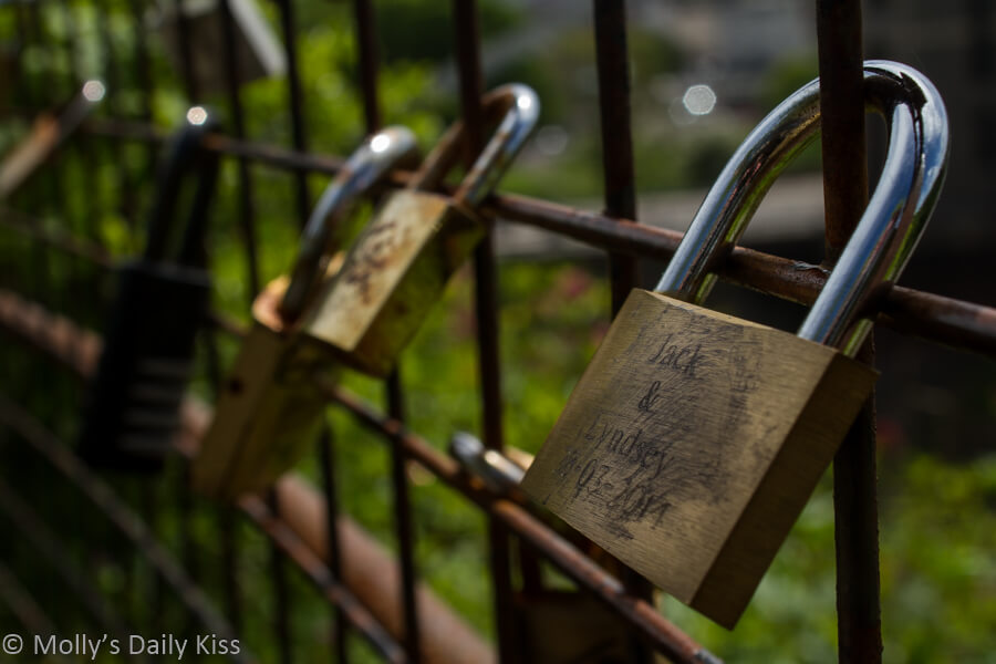 Padlock love on fence in Bristol at the Clifton Outlook