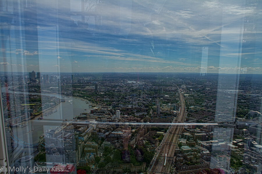 self portrait reflection in the glass of Shard looking out over London like mirages