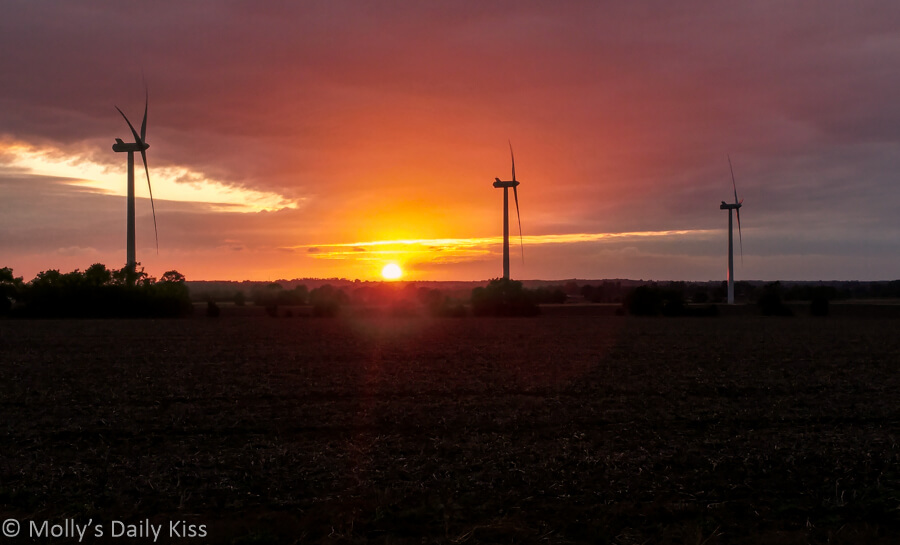 Sunset with wind farm. Remorseful Day