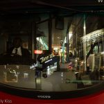 reflection in the front window of a london bus at night