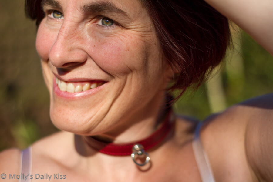 Molly wearing red collar smiling self portrait