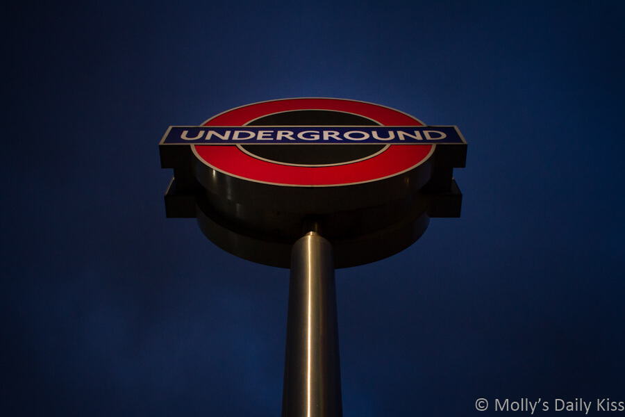 London Underground sign against shades of night sky