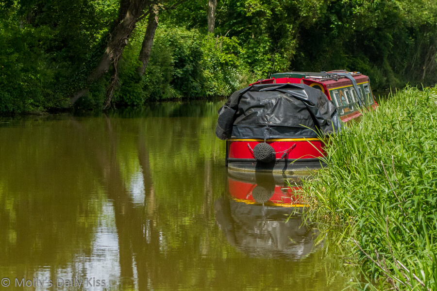 red canel boating reflected in the water