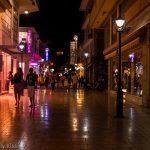 Night street lights and shop lights reflection in street in Argostoli Kefalonia