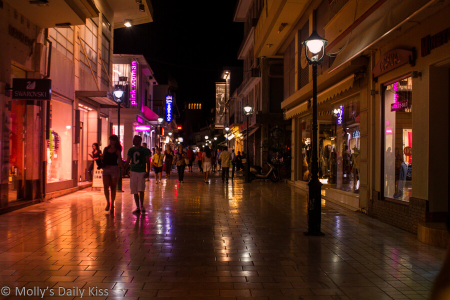 Night street lights and shop lights reflection in street in Argostoli Kefalonia