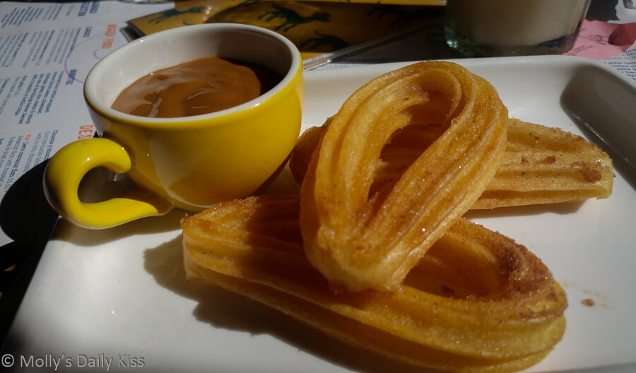 Churros with hot caramel sauce