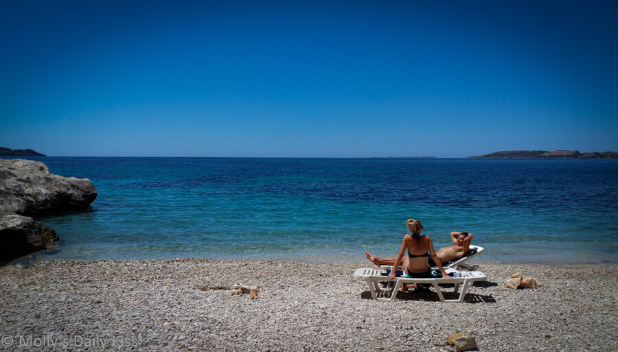Two people on the beach in Kefalonia Greece