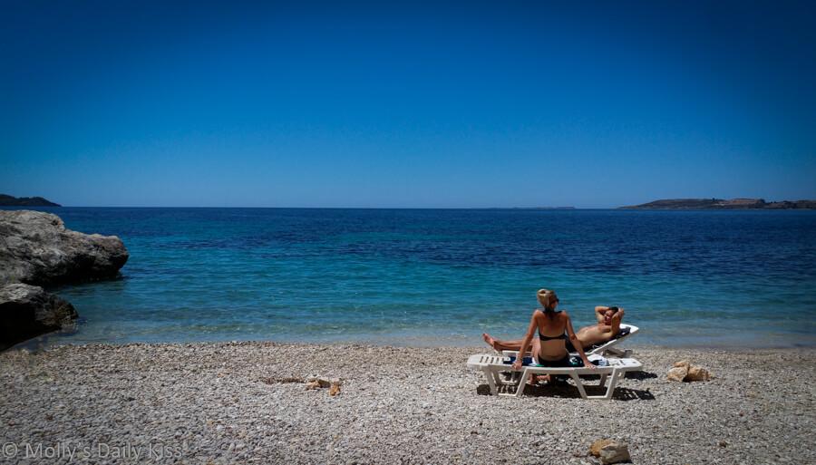 Two people on the beach in Kefalonia Greece