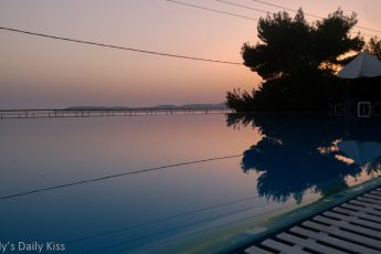 reflection of sunset in swimming pool in Kefalonia greece. Image title Allied