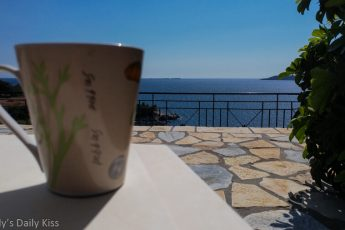 Cup of tea with a beautiful view of blue sea in Greece