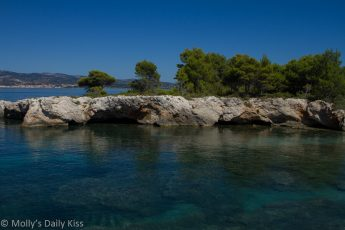 Blues of the water in cove in Kefalonia