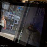 reflection of people taken in camera shop