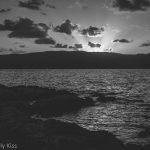 black and white sunset over the sea, cliche